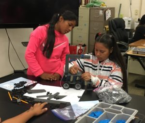 Two middle school students work on a robotics project in the 2018 Middle School Summer School Project Lead the Way Engineering Course.