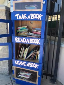 American Union's bight blue Lending Library Box is stationed just outside the main office at the school.