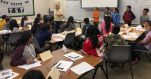 District elementary students being trained in peer mediation by  Fresno State Staff.