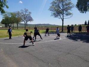 Alt. Ed Basketball team members play in a game against Kings Canyon.